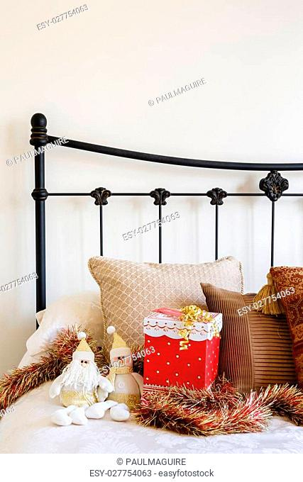 Christmas interior of contemporary bed against a neutral wall