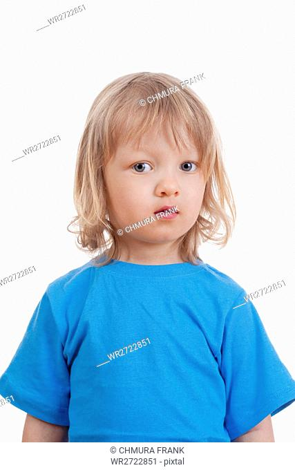 studio portrait of a boy with long blod hair - isolated on white