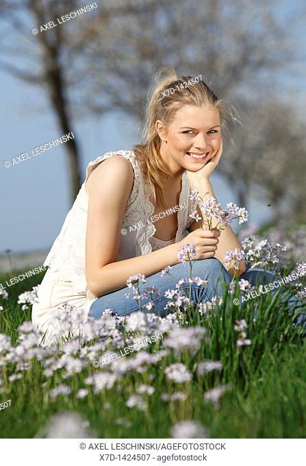woman picking wild flowers
