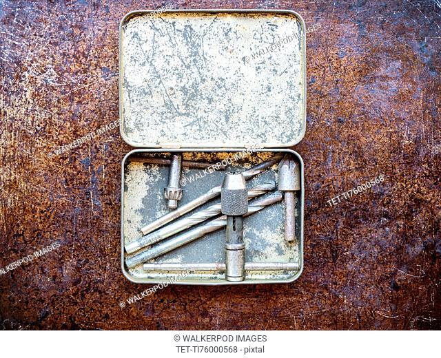 Drill bits in metal box