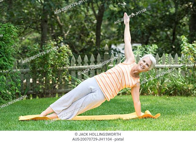 Mature woman exercising in a park