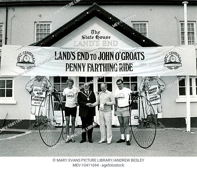 The start of an NSPCC Centenary pennyfarthing ride from Land's End in Cornwall to John o'Groats in Scotland, with two intrepid cyclists and the local mayor