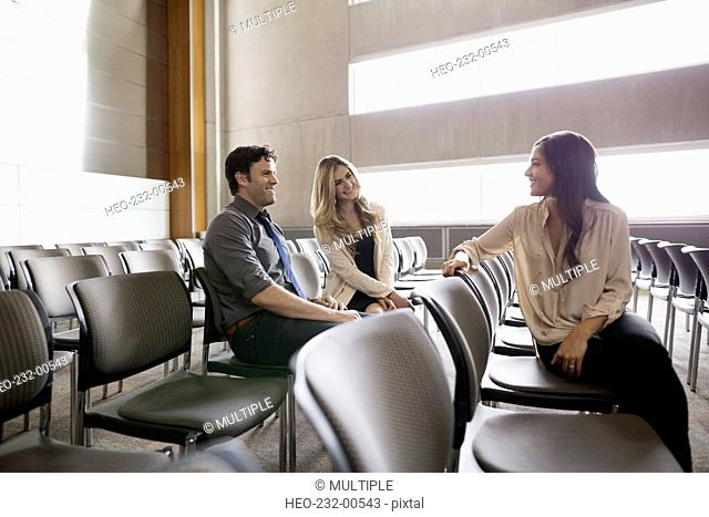 Students talking in auditorium