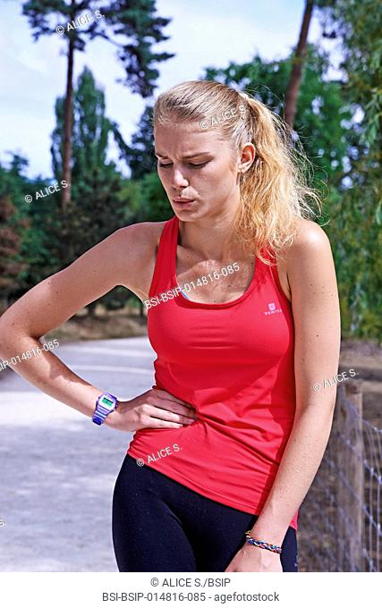 Jogger suffering from a side stitch