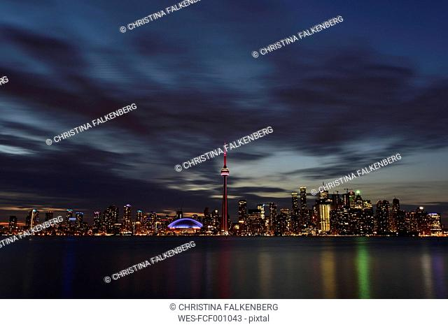 Canada, Ontario, Toronto, Skyline at night, moving clouds