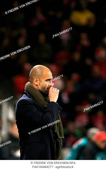 Munich's coach Pep Guardiola reacts during the Bundesliga soccer match between 1. FSVMainz 05 and FC Bayern Munich at Coface arena in Mainz, Germany