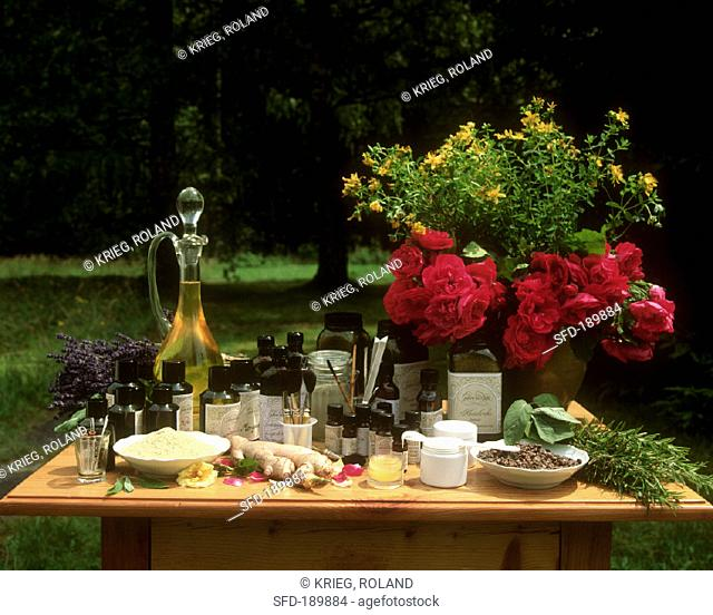 Natural cosmetics, medicinal plants & flowers on table