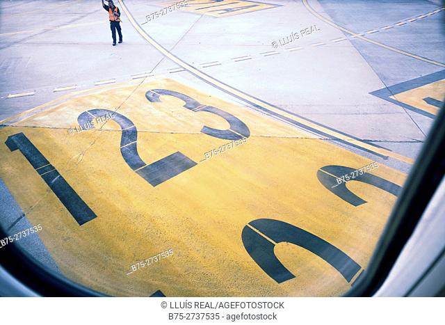 Runway seen from airplane window. Barcelona-El Prat Airport. Barcelona, Spain