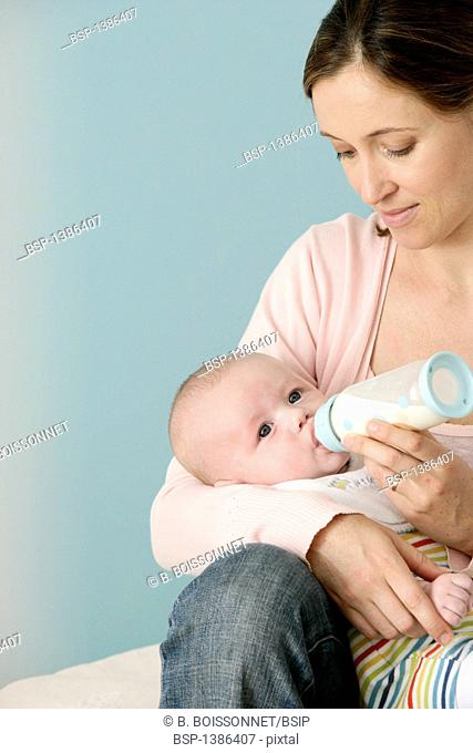INFANT DRINKING FROM BABY BOTTLE Models. 3-month-old baby boy