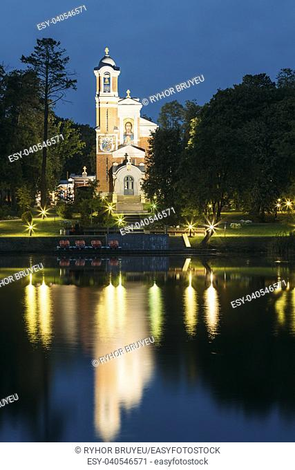 Mir, Belarus. View From Side Of Evening Lake Of Chapel And Burial Vault Of Svyatopolk-Mirsky Family In Bright Illumination