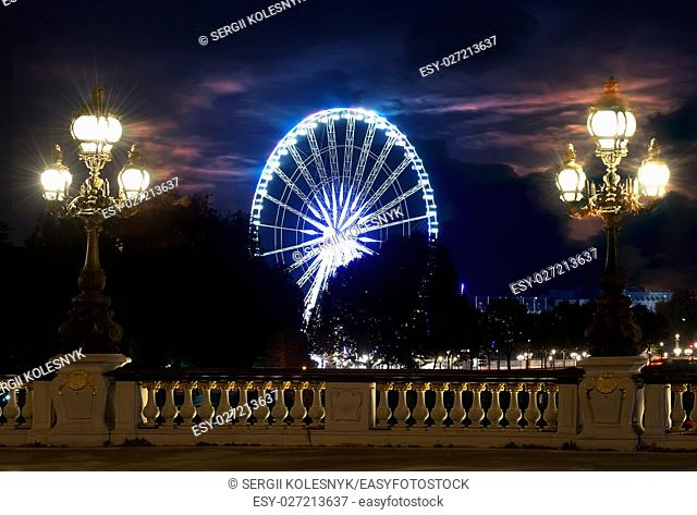 View on Ferris Wheel from Jardin des Tuileries in Paris, France