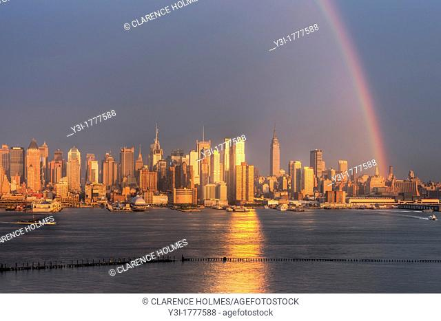 A rainbow appears over the Manhattan skyline in New York City shortly after a summer thunderstorm on Wednesday, August 15, 2012