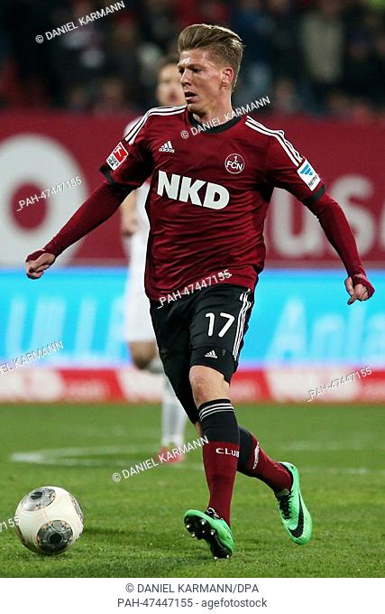 Nuremberg's Mike Frantz vies for the ball during the Bundesliga soccer match between 1. FC Nuremberg and VfB Stuttgart in the Grundig stadion in Nuremberg