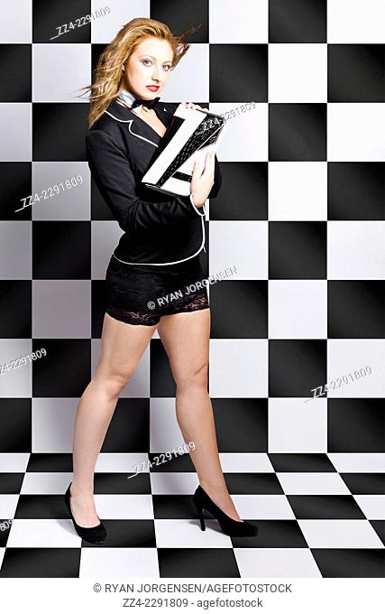Full length photo of beautiful girl posing in luxury fashion style holding black and white purse