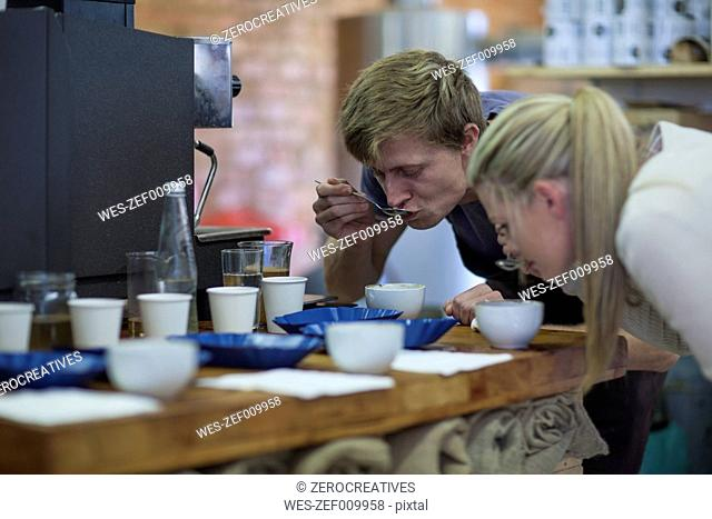 Woman and man tasting coffee