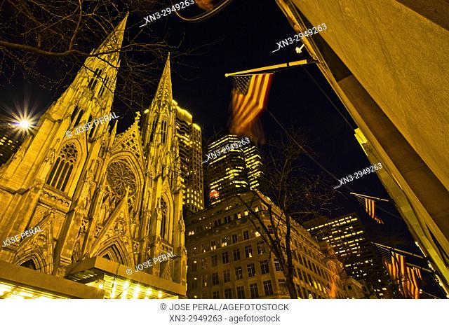 At left St. Patrick's Cathedral, 5th Avenue and 50th Street, Manhattan, New York, USA
