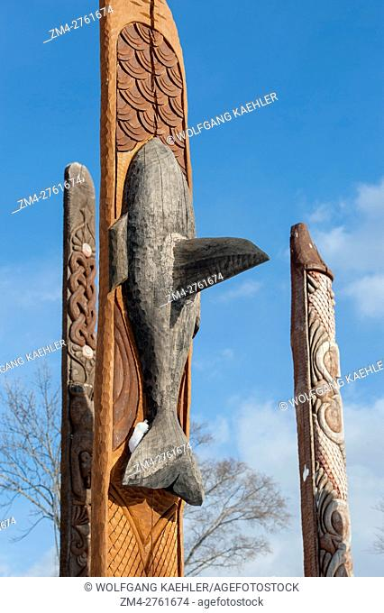 View of a killer whale (orca) on a carved wooden Ainu pole at the Ainu performance center in Ainu Kotan, which is a small Ainu village in Akankohan in Akan...
