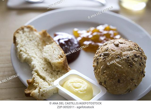 Breakfast with coffee bread butter and jam