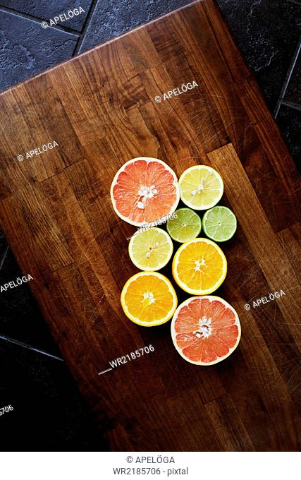 Directly above shot of sliced citrus fruits on chopping board