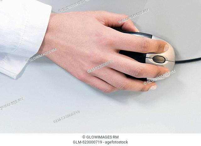 Close-up of a businesswoman's hand using a computer mouse