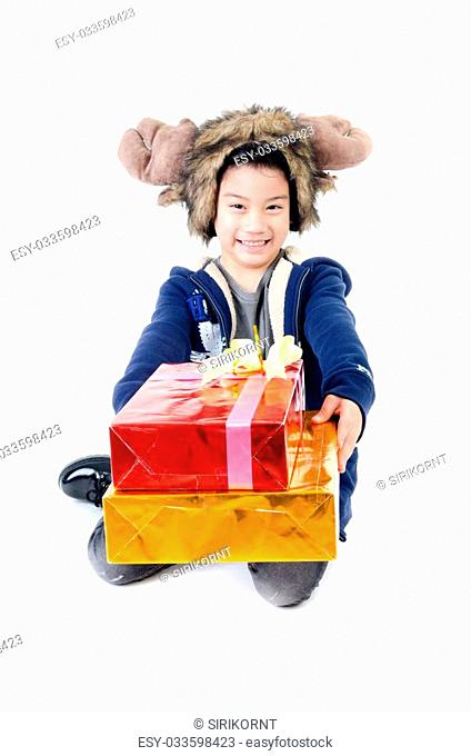 Asian cute boy with gift box represents Christmas theme