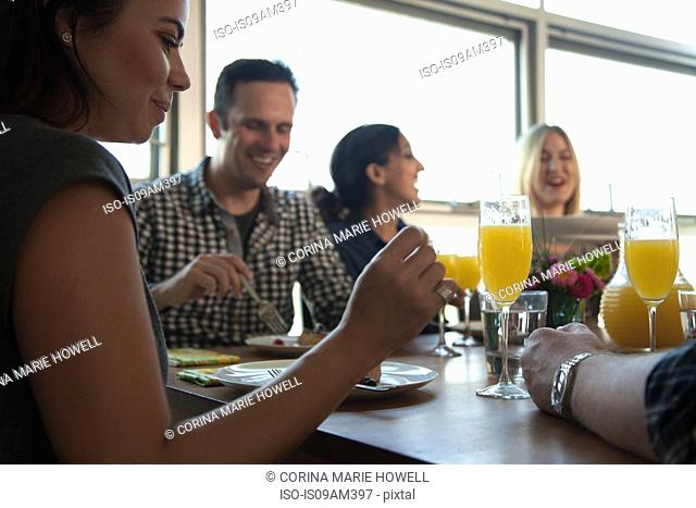 Group of friends having meal at table, low angle view