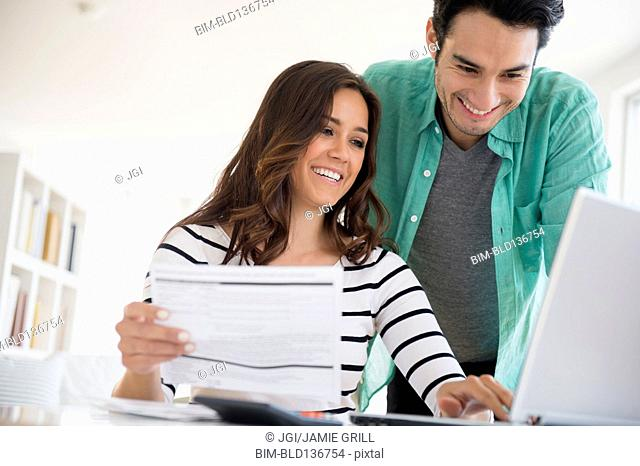 Couple paying bills together online