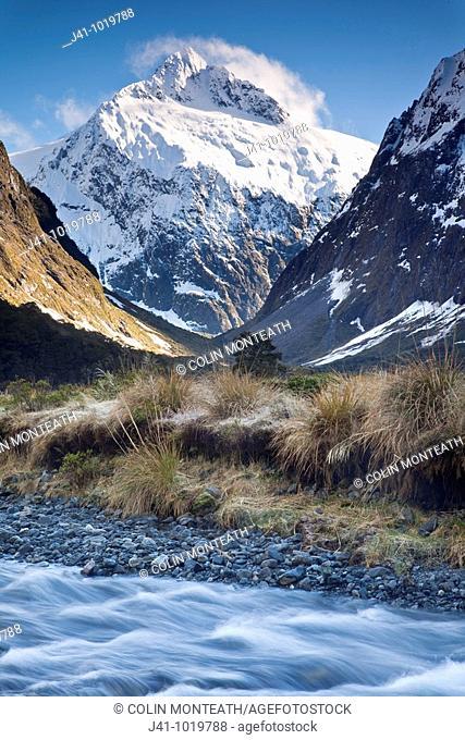 Mt Talbot under winter snow, Hollyford River near Homer tunnel, Fiordland National Park, World Heritage, New Zealand