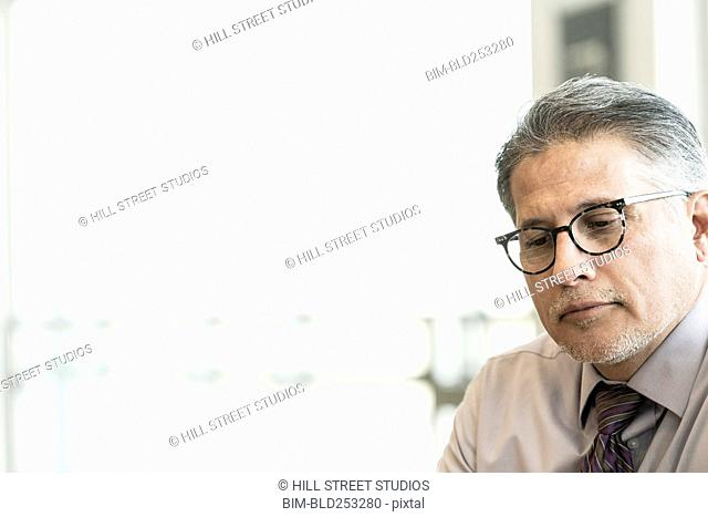Pensive Hispanic businessman