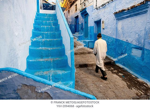 Man walking in a street. Chefchaouen old town ( medina), Morocco