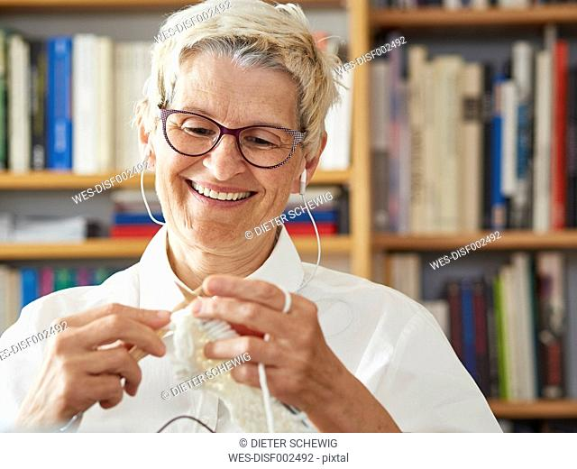 Portrait of knitting senior woman