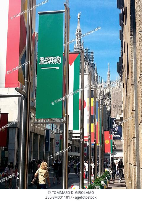 Italy, Lombardy, Milan, Vittorio Emanuele street, flags for expo