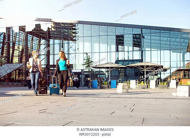 Businesswomen walking by central station