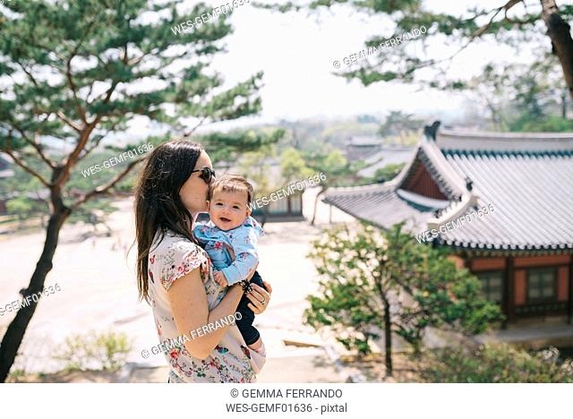 South Korea, Seoul, Mother and baby girl visiting Changdeokgung Palace and Huwon