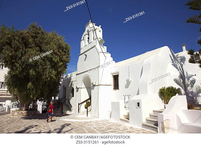 Tourist in front of the Panagia Pantanassa, once part of a Byzantine monastery in the town center Chora, Naxos Island, Cyclades Islands, Greek Islands, Greece