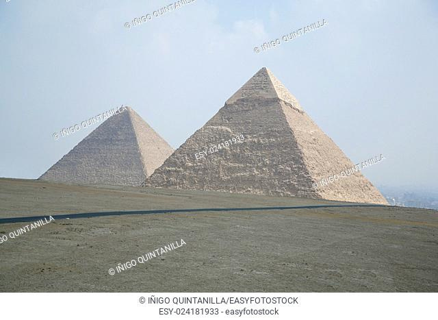 landmark of two pyramids in Giza next to Cairo city Egypt, Africa, the pyramid of Khafre pharaoh and behind the Great Pyramid of Khufu