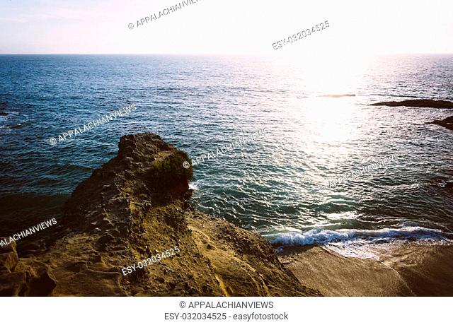 Cliffs and sunset over the Pacific Ocean at Table Rock Beach, in Laguna Beach, California