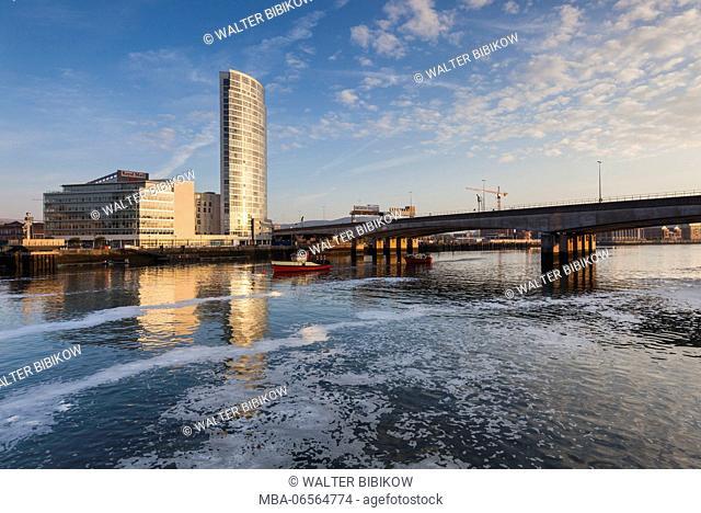 UK, Northern Ireland, Belfast, city skyline along River Lagan, dawn