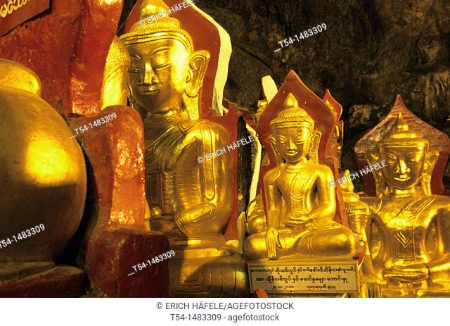 Golden Buddha statues in the Pindaya cave in Myanmar