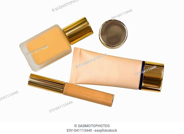Packages of cosmetic makeup, bottle of liquid foundation, long wear lightweight, flawless wear creamy concealer and skin care product isolated on white...
