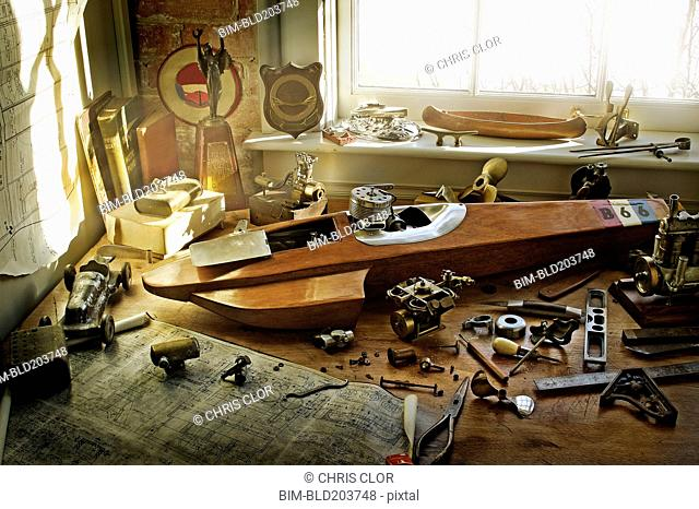 Boat, map, and sailing paraphernalia on desk