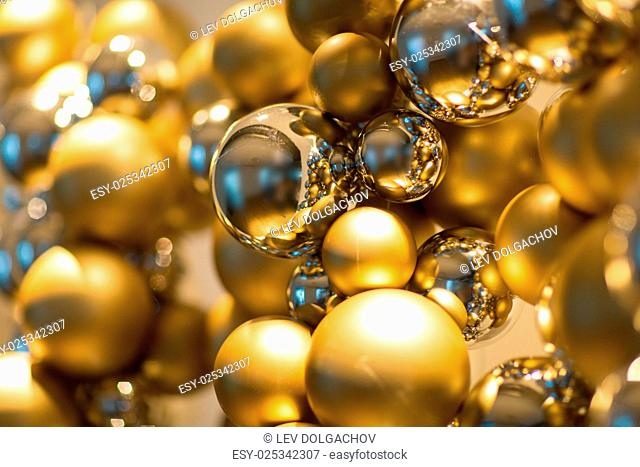 holidays and luxury concept - close up of golden christmas decoration or garland of beads or balls