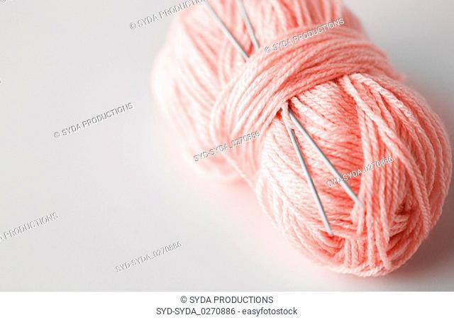 knitting needles and ball of pink yarn