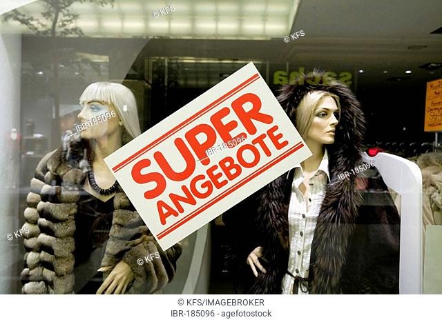 Window of a fur shop with sales announcement poster, Koenigsalle, Duesseldorf, NRW, Germany