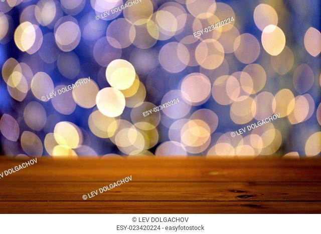 holidays, new year and celebration concept - close up of empty wooden surface or table over christmas golden and blue lights background