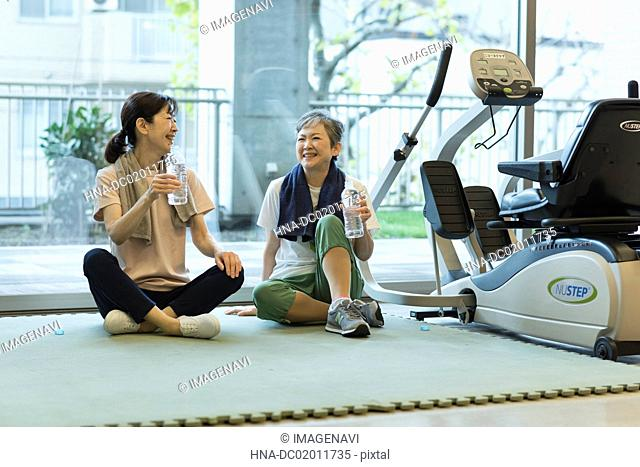 Senior woman chatting at gym