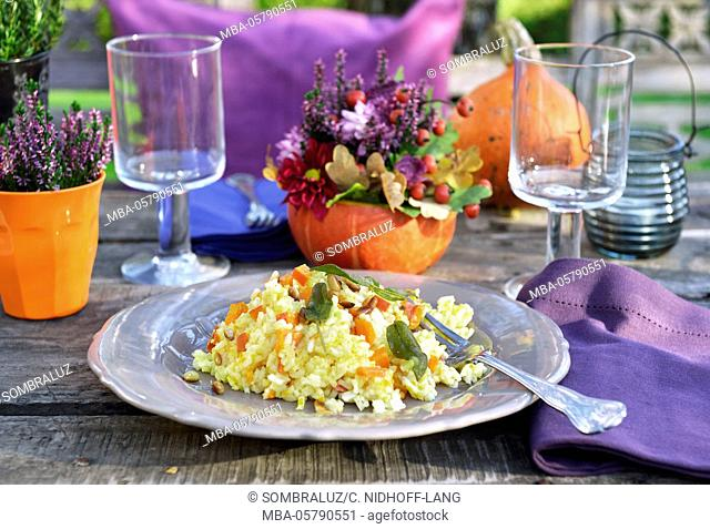 Pumpkin risotto on setted table