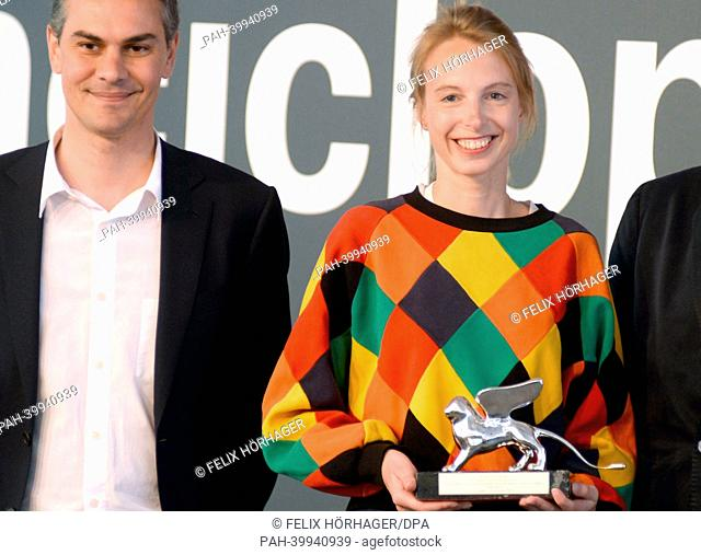 Artist Camille Henrot poses for a photo with Silver Lion award for the best Young Artist in Venice, Italy, 31 May 2013. Next to her stands Massimiliano Gioni