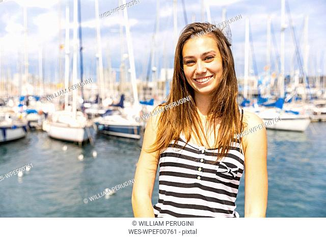Portrait of smiling young woman at a marina
