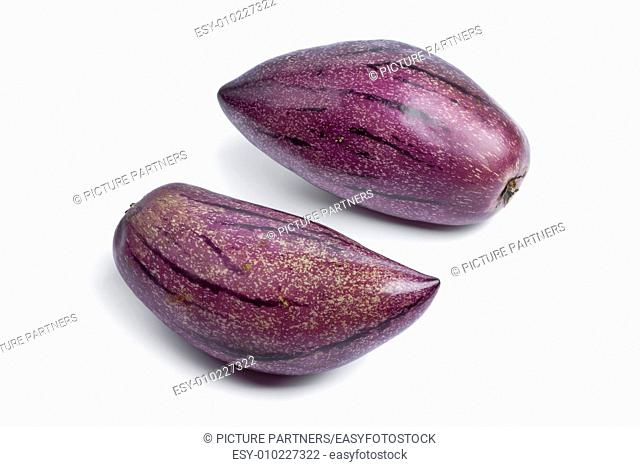 Fresh whole ripe pepino fruit on white background